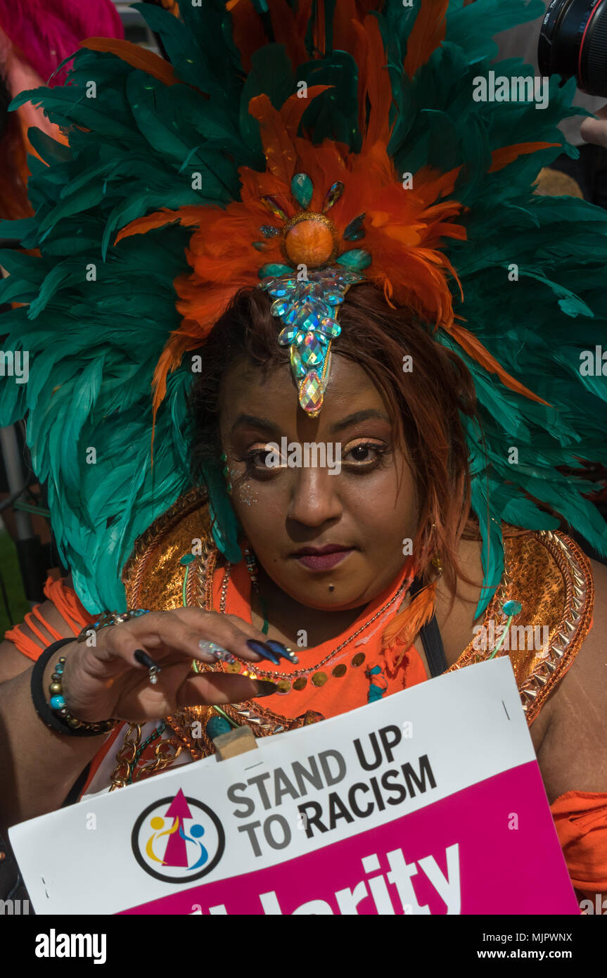 London, UK. 5th May 2018. One of several women who  came in carnival costumes for the rally at Downing St and protest outside the Home Office calling for Theresa May's racist 2014 Immigration Act to be repealed and an immediate end to the deportation and detention of Commonwealth citizens, with those already deported to be bought back to the UK. There should be an end Credit: Peter Marshall/Alamy Live News Stock Photo