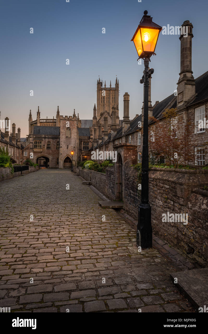 Somerset, UK, 5 May 2018. UK Weather - After a beautiful sunny Bank Holiday Saturday in Wells, the tourists depart and leave the picturseque Vicars' Close deserted as dusk falls and the streetlights come on in Somerset. Credit: Terry Mathews/Alamy Live News - Stock Image