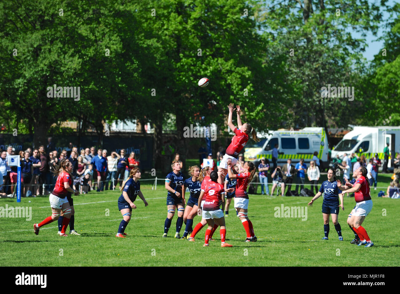 London, UK, 5 May 2018. Ellie Gattlin (LCpl, British Army, Vice-Captain) being lifted up to catch the ball after a thrown in during the annual women's annual inter-service competition match at Kneller Hall, London, UK.  The match was won by the British Army, 72-3.    In 2003 a Women's Inter-Service Competition was introduced to run alongside the men's competition. The inaugural competition was w Credit: Michael Preston/Alamy Live News - Stock Image