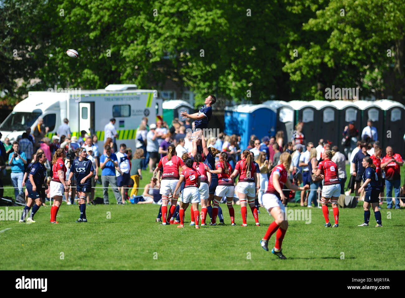 London, UK, 5 May 2018. Lauren Salisbury (LWTR, Royal Navy) being lifted up to catch the ball after a thrown in during the annual women's annual inter-service competition match at Kneller Hall, London, UK.  The match was won by the British Army, 72-3.    In 2003 a Women's Inter-Service Competition was introduced to run alongside the men's competition. The inaugural competition was won by the Arm Credit: Michael Preston/Alamy Live News - Stock Image