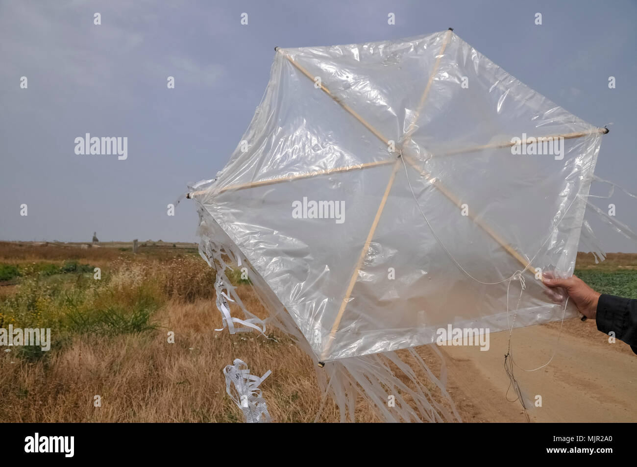 Kite bomb. Simple, homemade kites are flown over the Israeli border with a fire bomb attached.