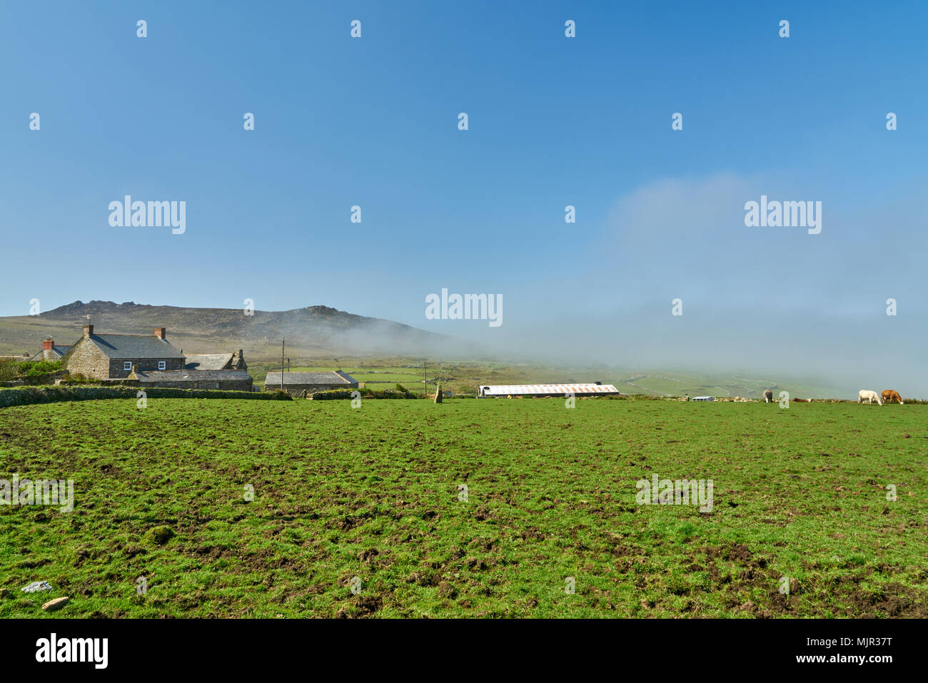 Higher Porthmeor Cornwall UK, Sunday 6 May 2018, The mist clears in West Cornwall to reveal a standing stone in the field and Carn Galva in the background. today looks set to be a fine Bank Holiday Sunday for much of the UK. Credit: Samuel Davey/Alamy Live News - Stock Image
