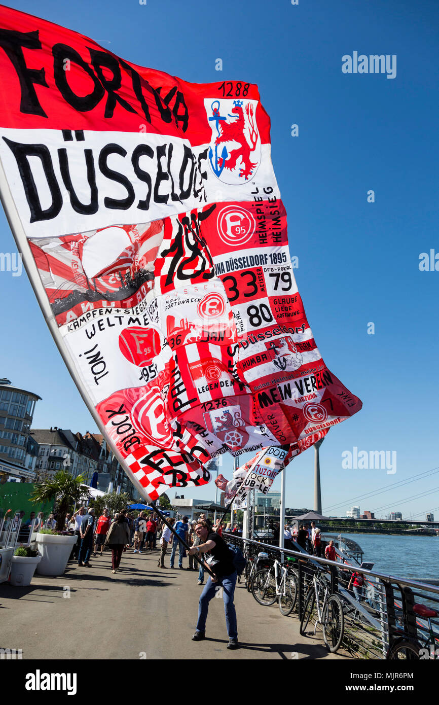 Düsseldorf, Germany. 6 May 2018. Fans of football club Fortuna Düsseldorf wave huge flags as they celebrate the promotion to the Bundesliga. Photo: 51North/Alamy Live News - Stock Image