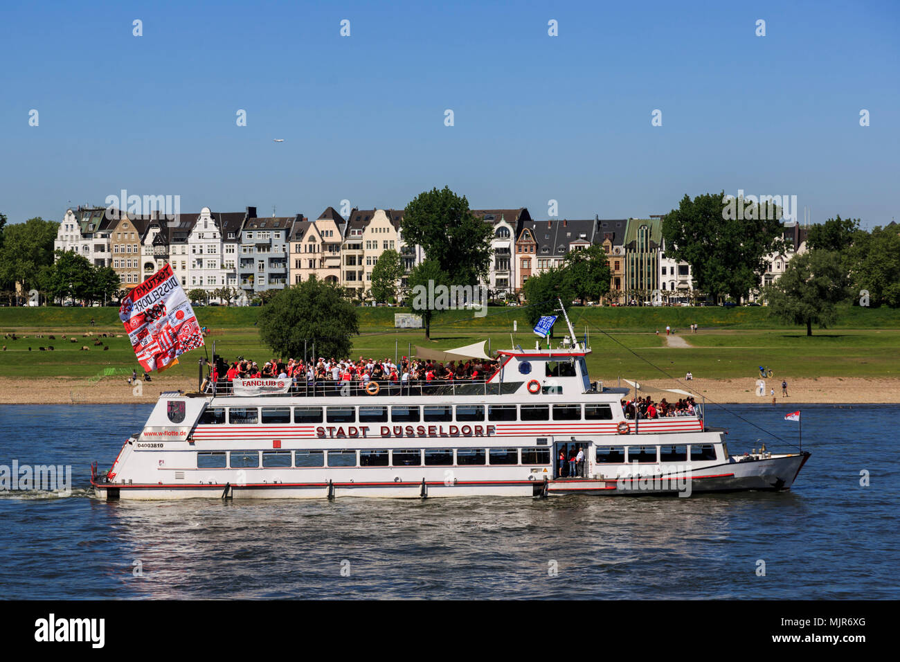 Düsseldorf, Germany. 6 May 2018. Fans of football club Fortuna Düsseldorf celebrate the promotion to the Bundesliga with a cruise on a pleasure boat on the River Rhine. Photo: 51North/Alamy Live News - Stock Image