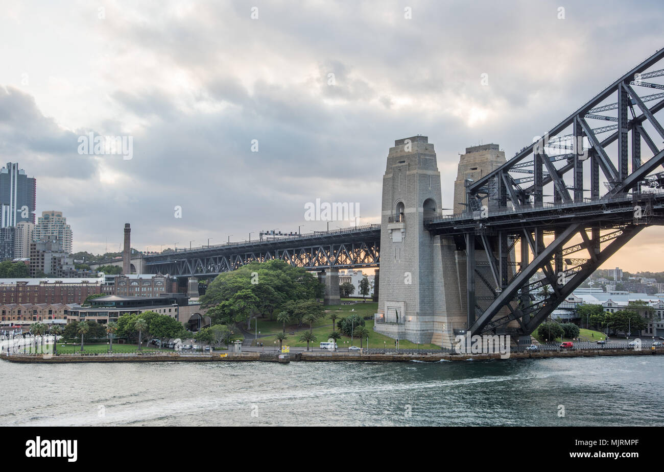 Sydney,NSW,Australia-December 7,2016: Sydney Harbour Bridge section with pylon lookout and waterfront area at sunset in Sydney, Australia Stock Photo