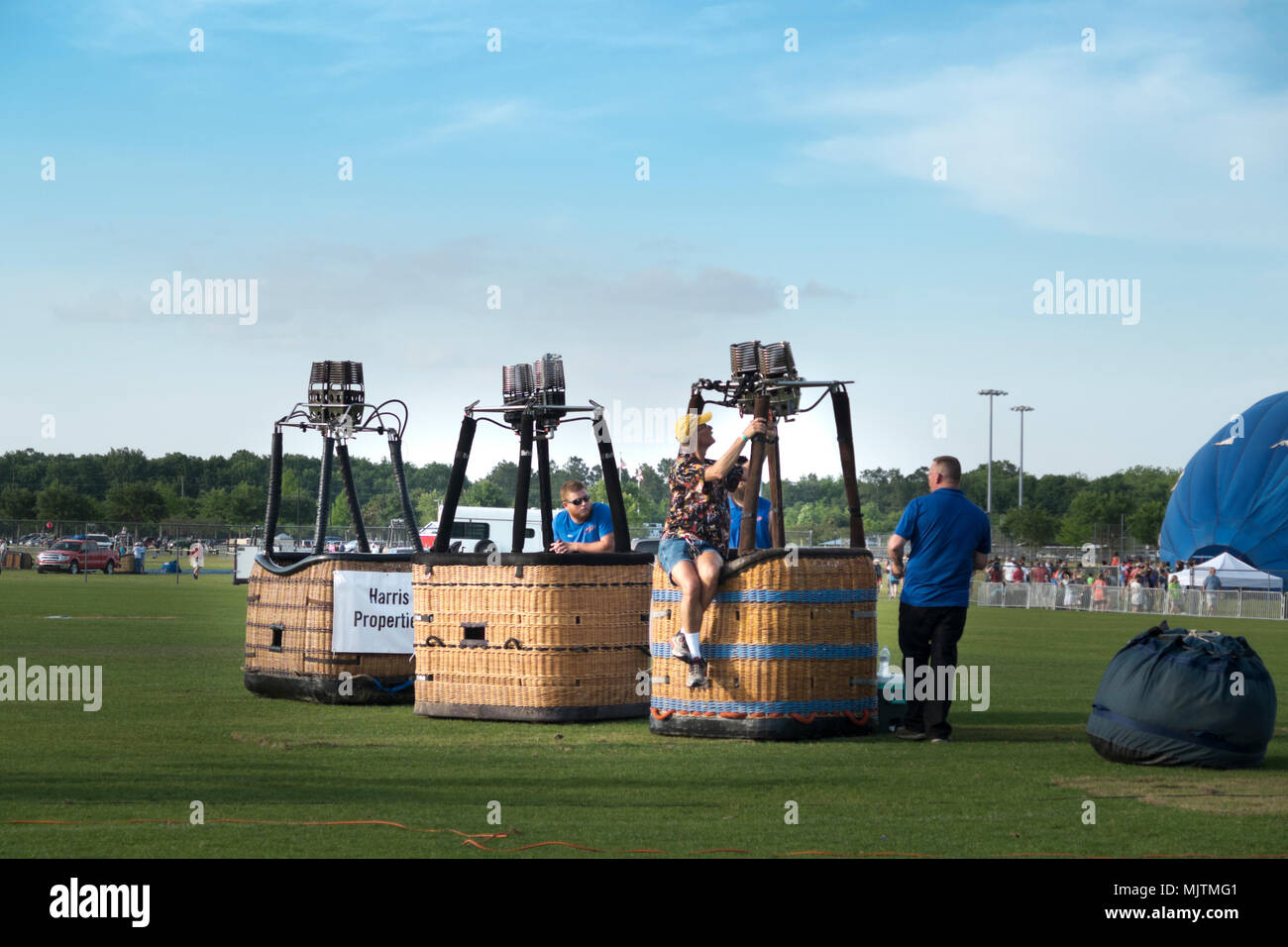 Preflight check on gas controls in the baskets of hot air ballons at the 14th annual Hot Air Balloon Festival at Foley, Alabama. - Stock Image