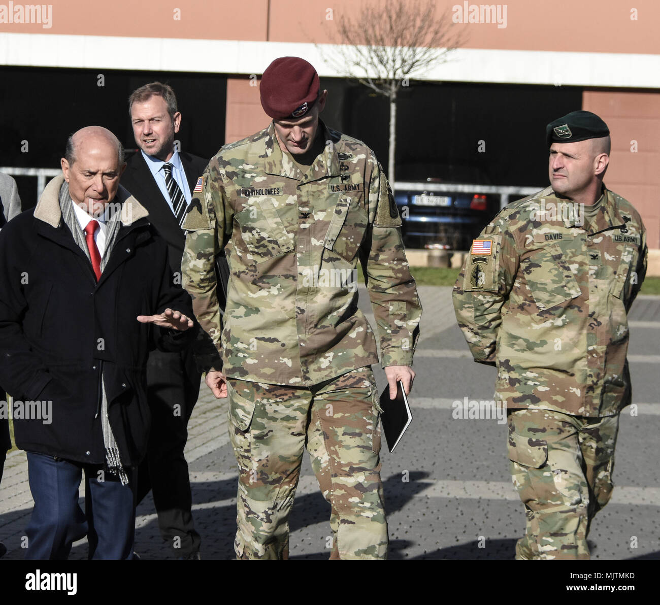 "US Ambassador to Italy, Lewis Eisenberg, talks with 173rd Airborne Brigade commander, Colonel James Bartholomees about the role of the ""Sky Soldiers"" in the defense of Europe. Stock Photo"