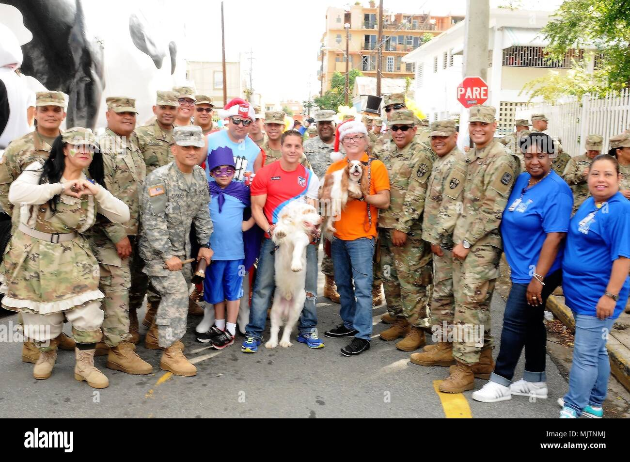 The Puerto Rico National Guard joined to the celebration of the San Jorge Children's Hospital Christmas Parade in Santurce, Puerto Rico, Dec. 21, in solidarity with the mission of the hospital to ensure the health and wellness of our children. Television and sports personalities and singers participate in the activity, as well as children's favorite characters. (PRNG photos by: Spc. Hamiel Irizarry/Released-PAO) - Stock Image
