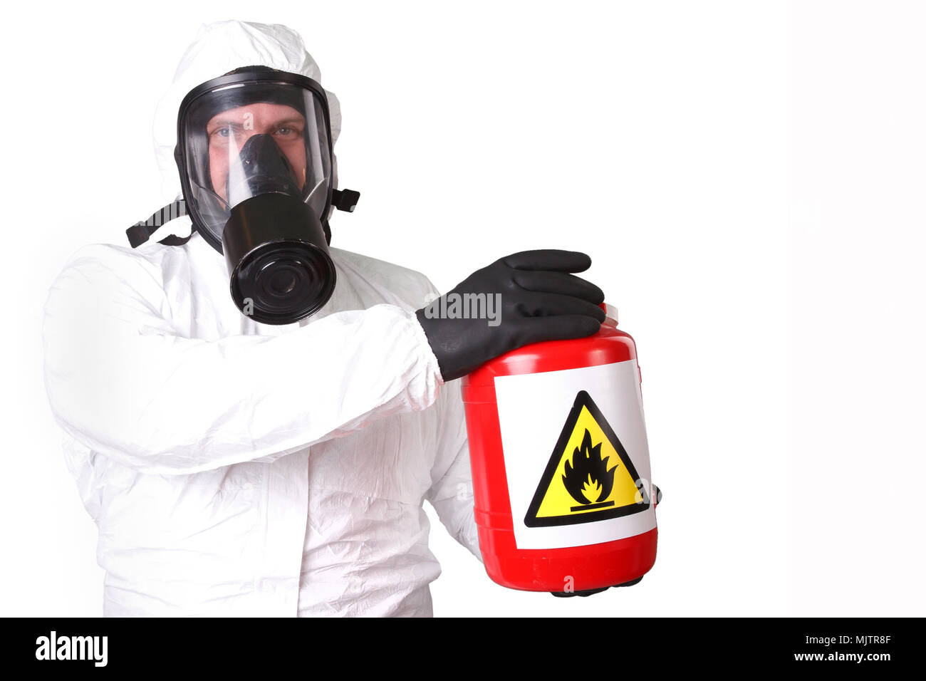 Man in a hazmat suit with red container dangerous material isolated on white - Stock Image