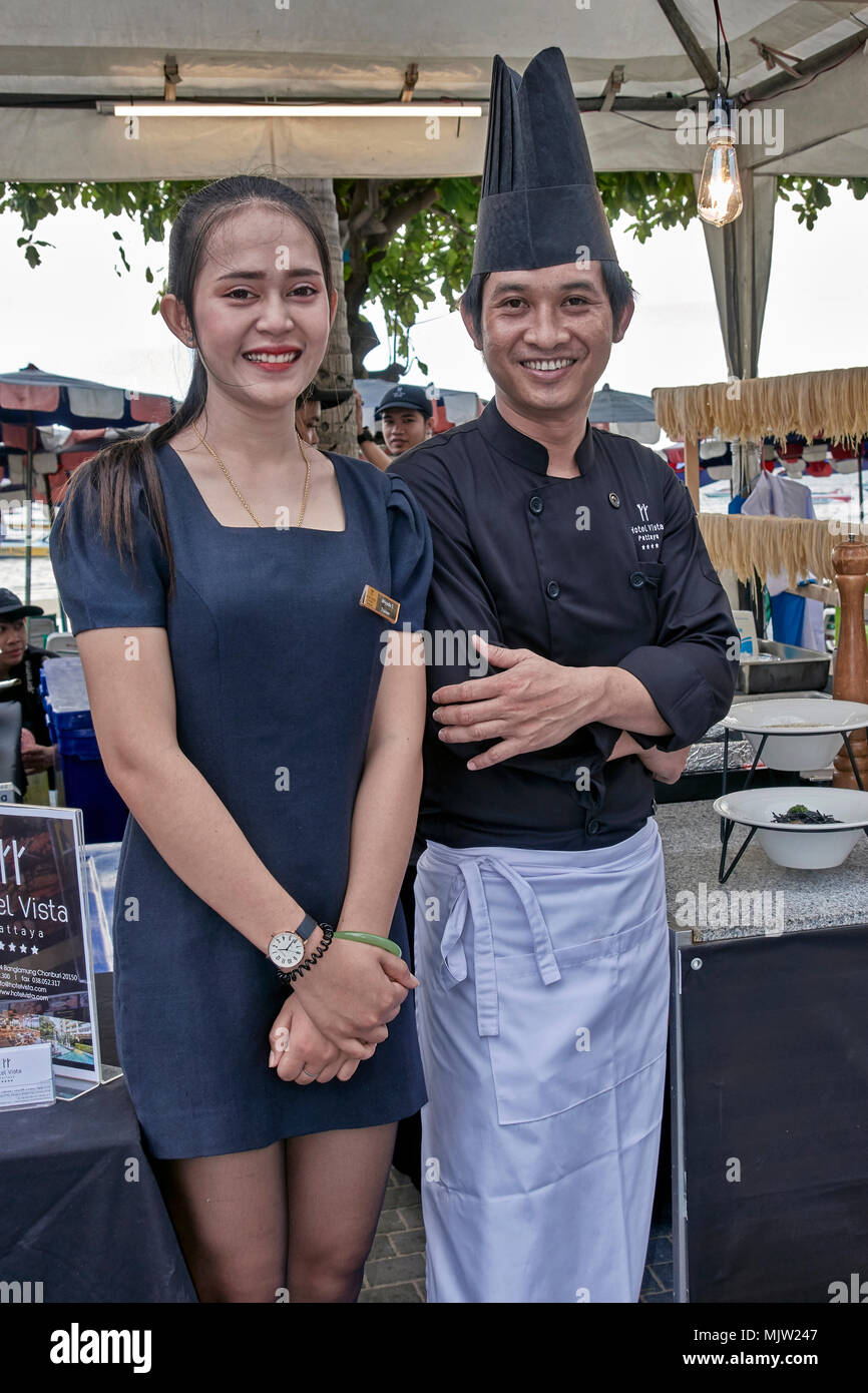 Chef and promotion girl manning the stall at an outdoor food festival in Pattaya, Thailand, Southeast Asia - Stock Image