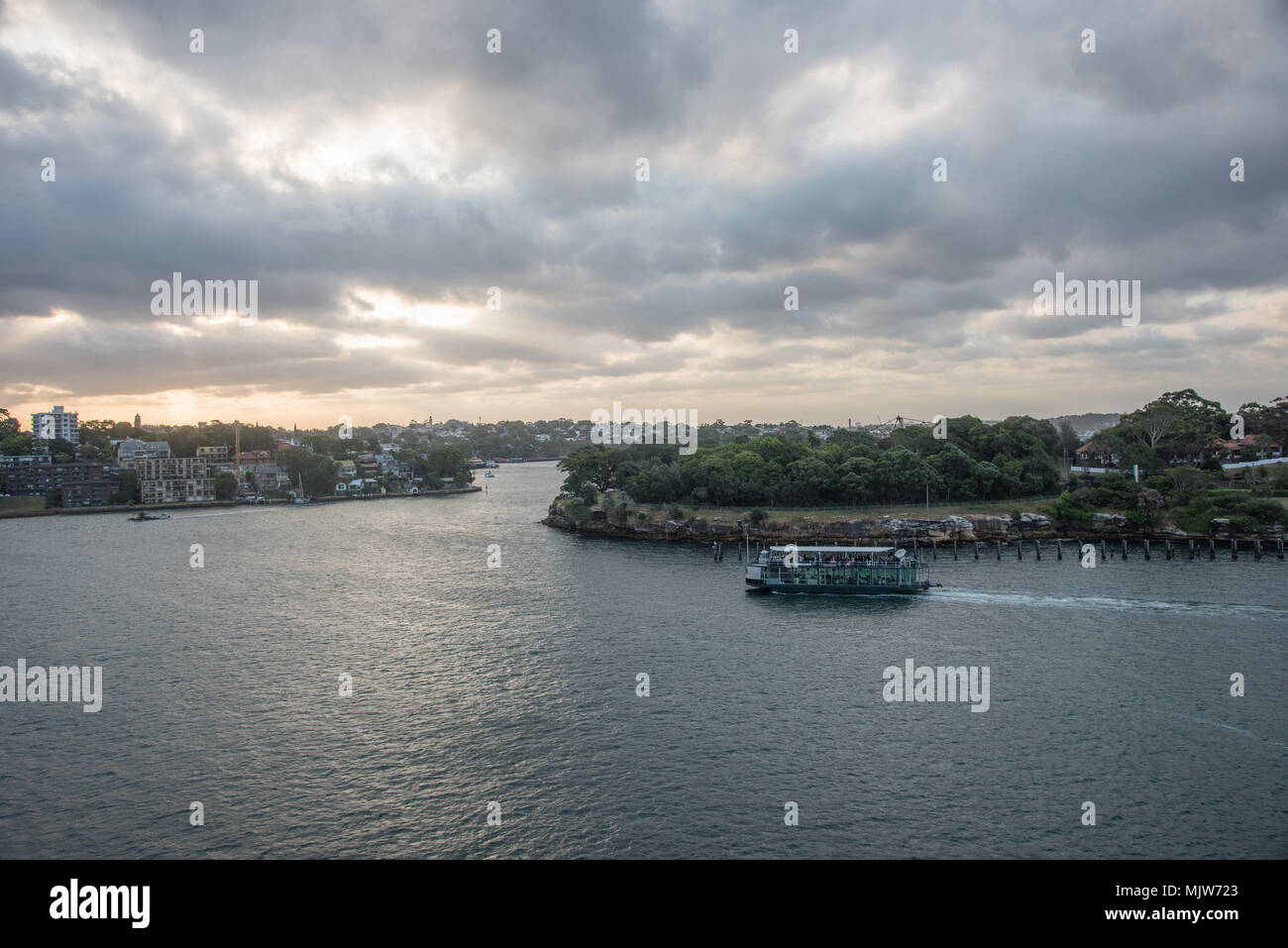 Sydney,NSW,Australia-December 7,2016: Tourists on boat cruising in the harbour at sunset in Sydney, Australia Stock Photo