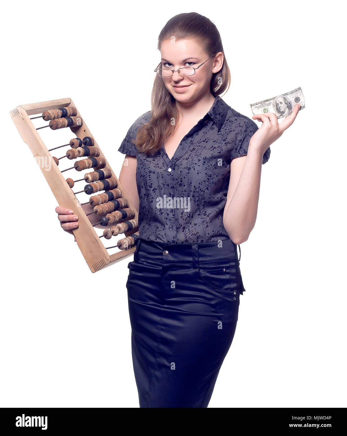 Girl with a wooden abacus and dollars in the hands of - Stock Image