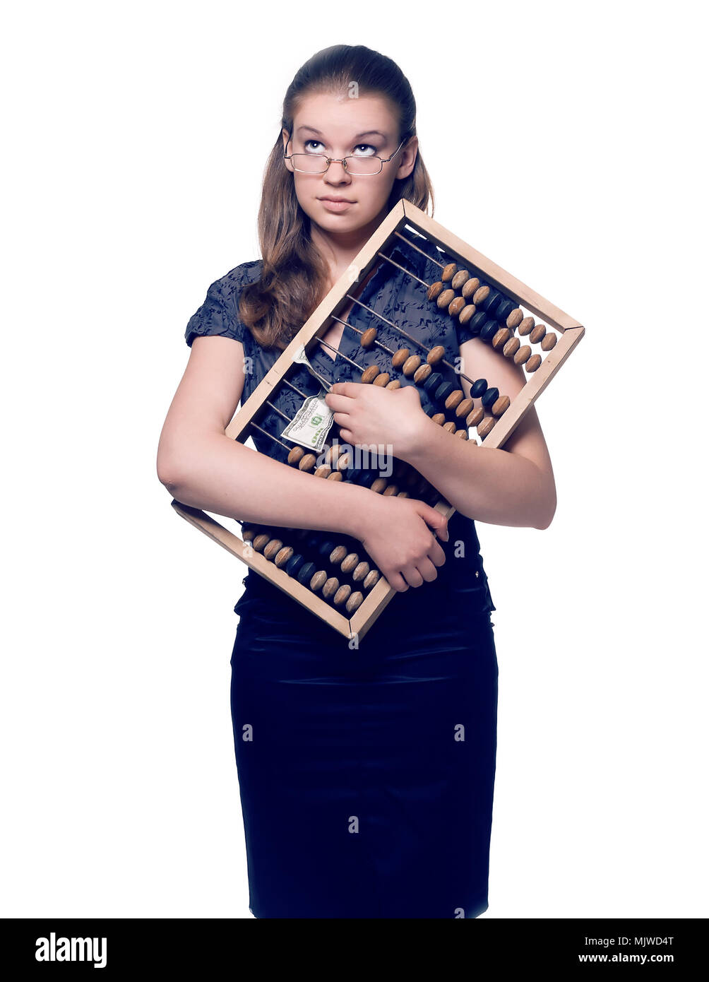girl pressed her to his chest wooden abacus and money - Stock Image