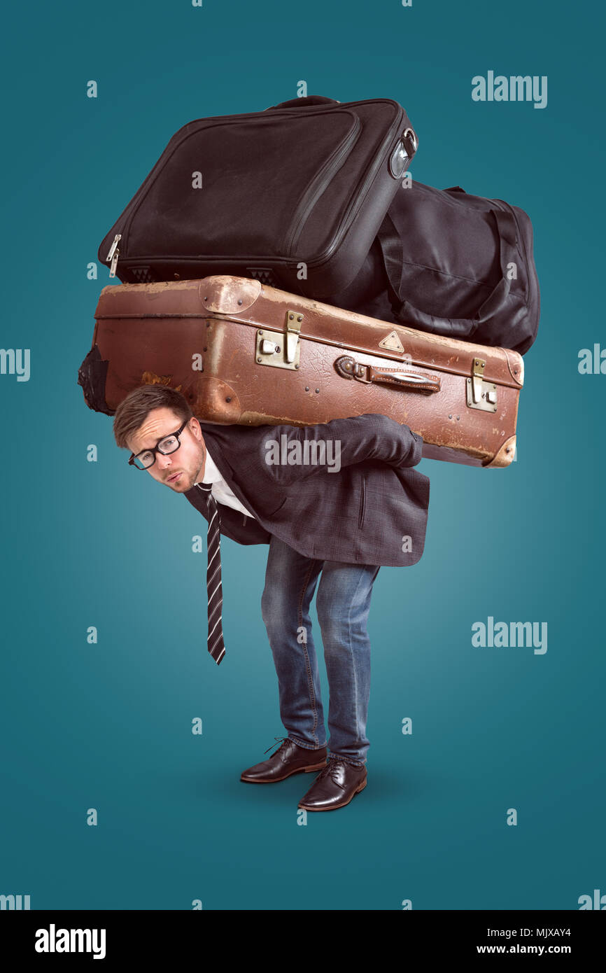Man with heavy baggage - Stock Image