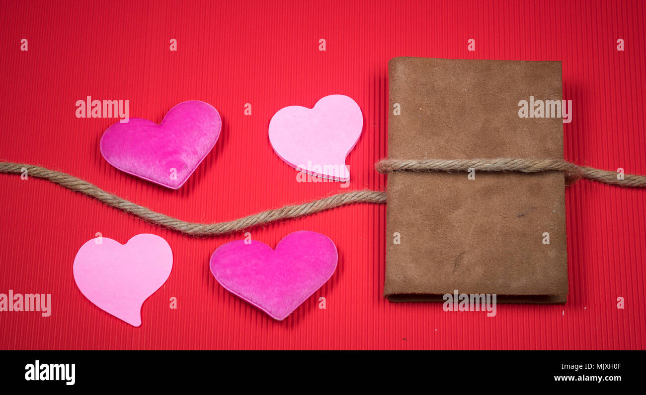 Valentine Background With Sewed Pillow Hearts Row Border On Red