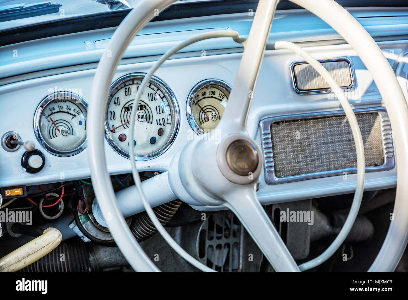 Steering wheel and dashboard in historic vintage red car  Retro