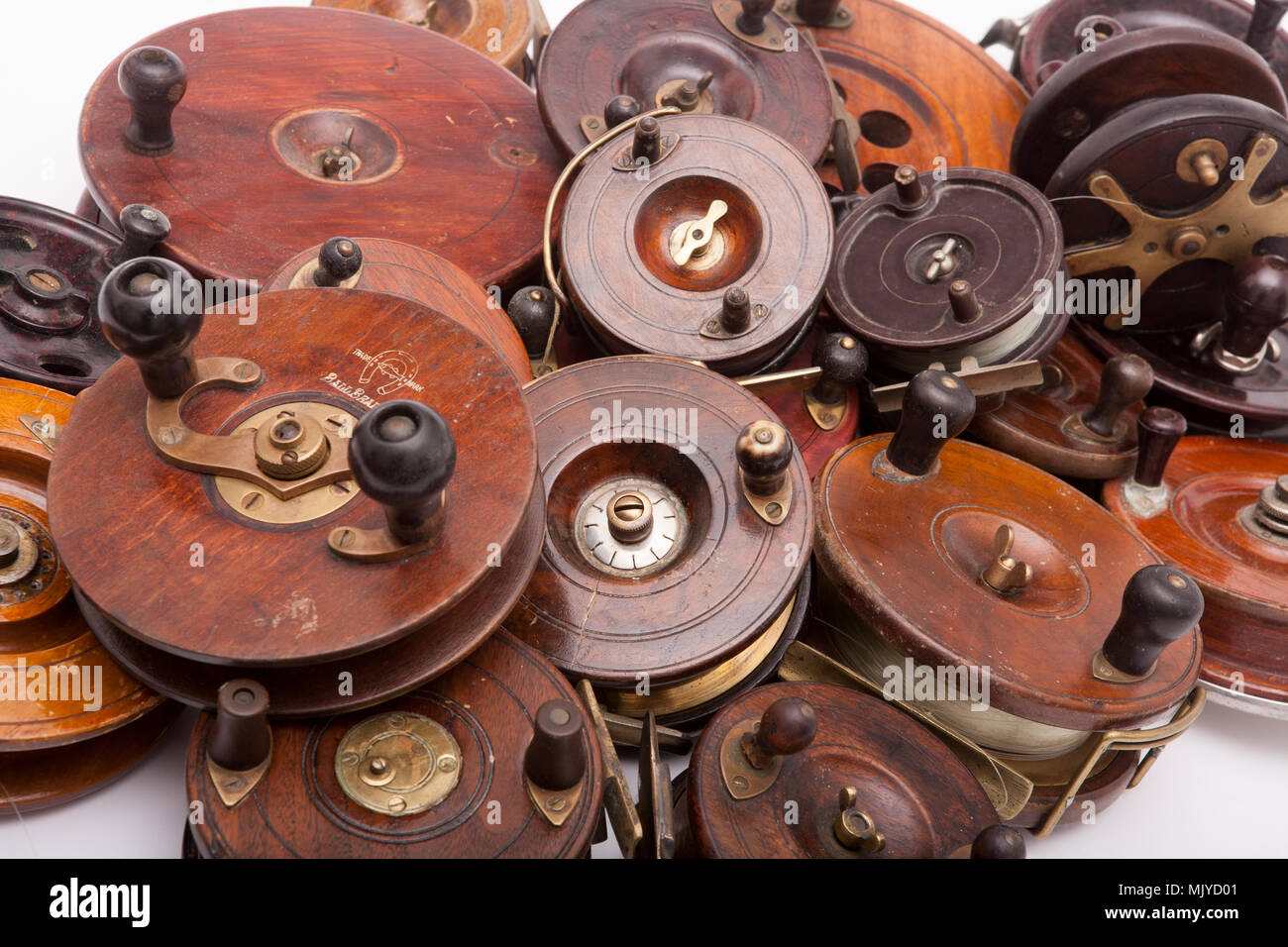 A collection of mostly wooden centrepin fishing reels from a large fishing tackle collection. Dorset England UK Stock Photo