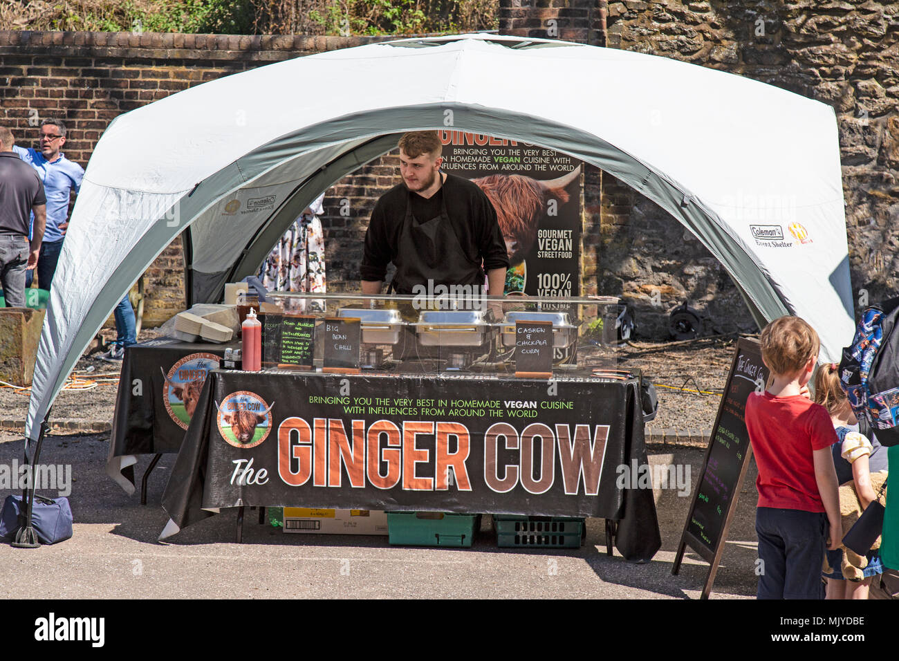 A stall called Ginger Cow selling vegan food at a street food festival in England. - Stock Image