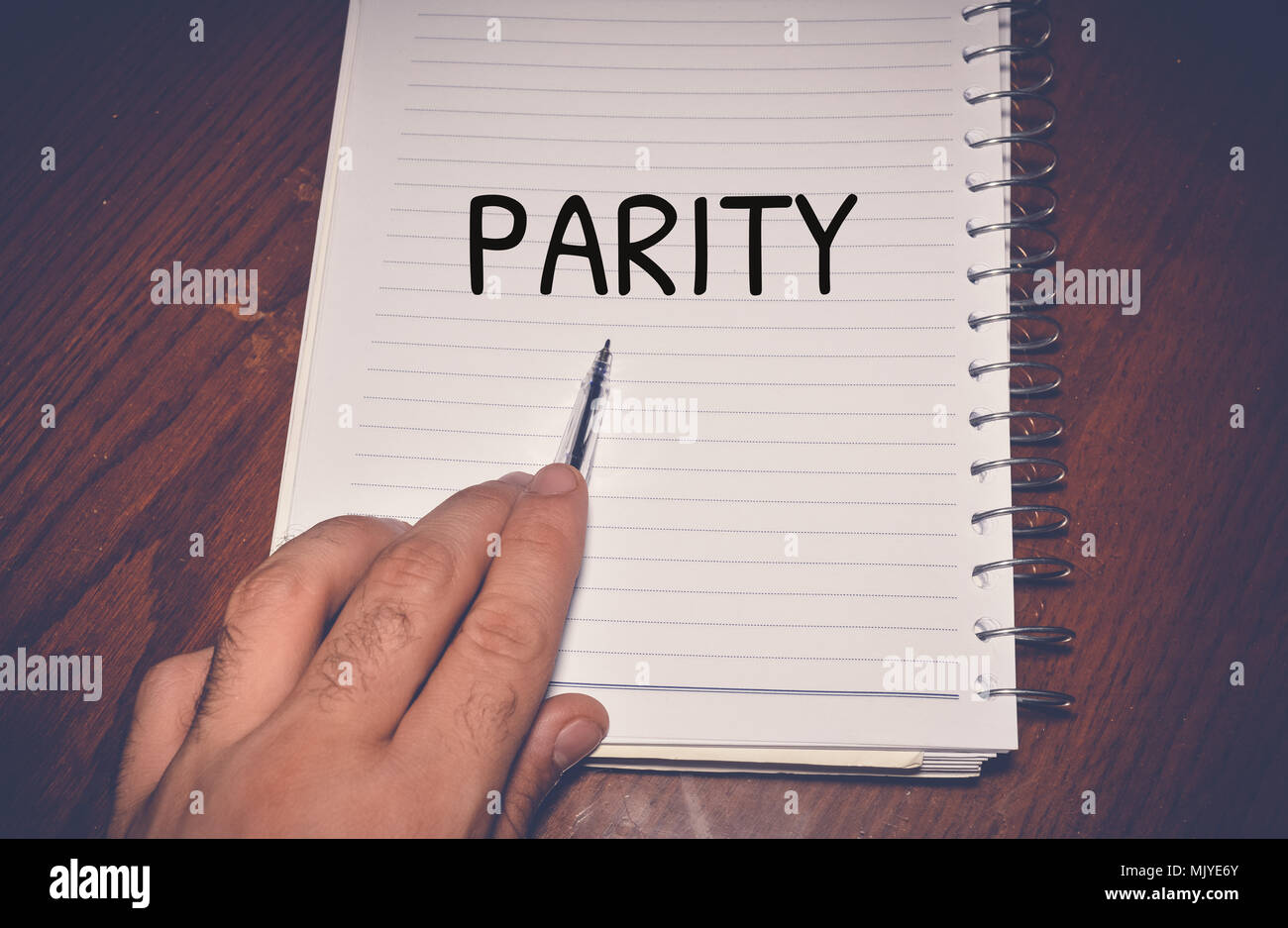 Parity word written on white paper - Stock Image