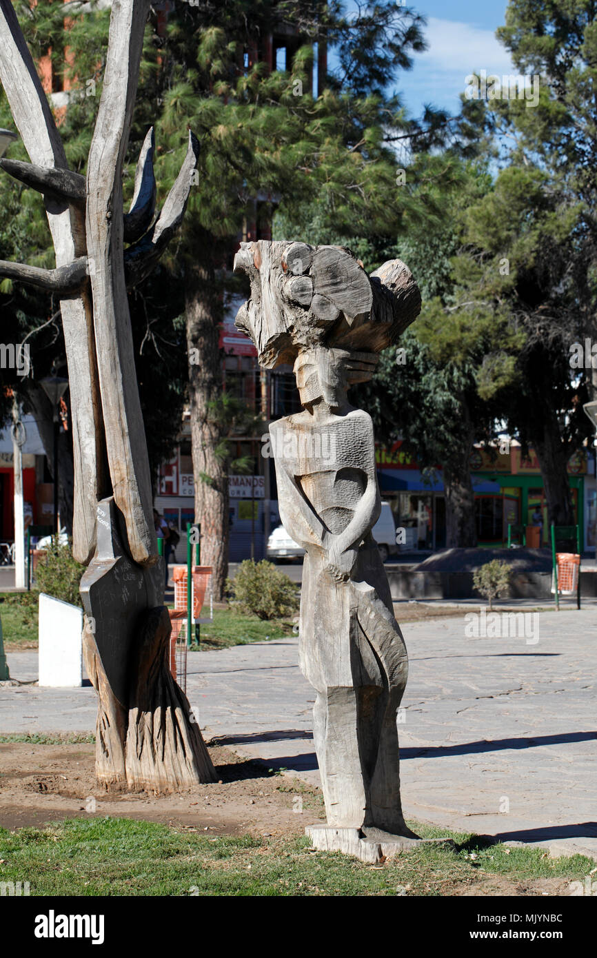 Puerto Madryn street art, tree stump carving of an African woman - Stock Image