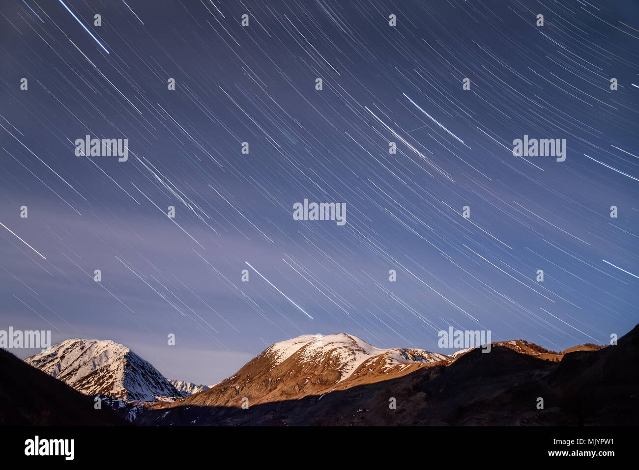 Beautiful Traces Of Stars In The Form Tracks And Blurred Clouds On Blue Night