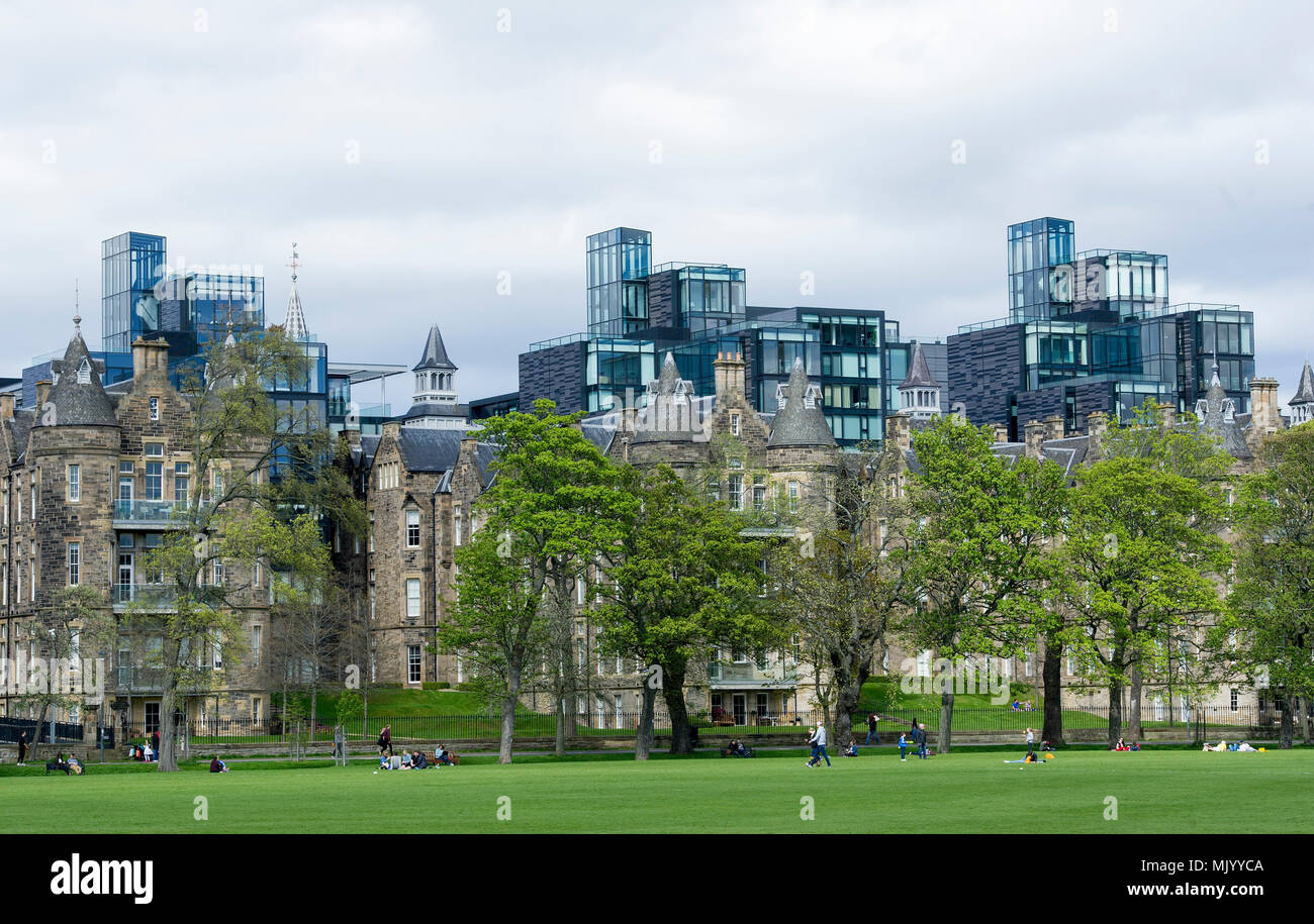 The apartments of the Quartermile development rise above the trees in the Meadows Edinburgh - Stock Image