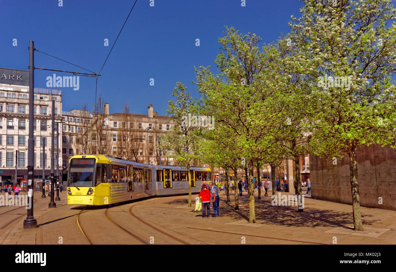 Manchester metrolink tram in Piccadilly Square, Manchester city centre, Greater Manchester, England, UK. - Stock Image