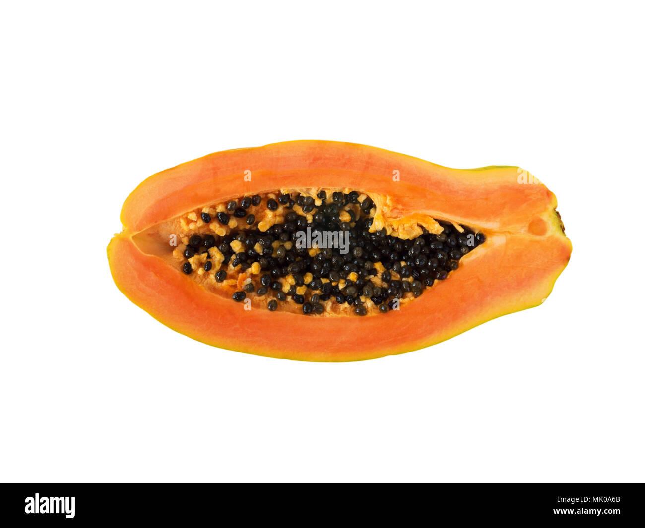 Ripe orange papaya exotic fruit with black seeds half cut top view flat lay isolated on white - Stock Image