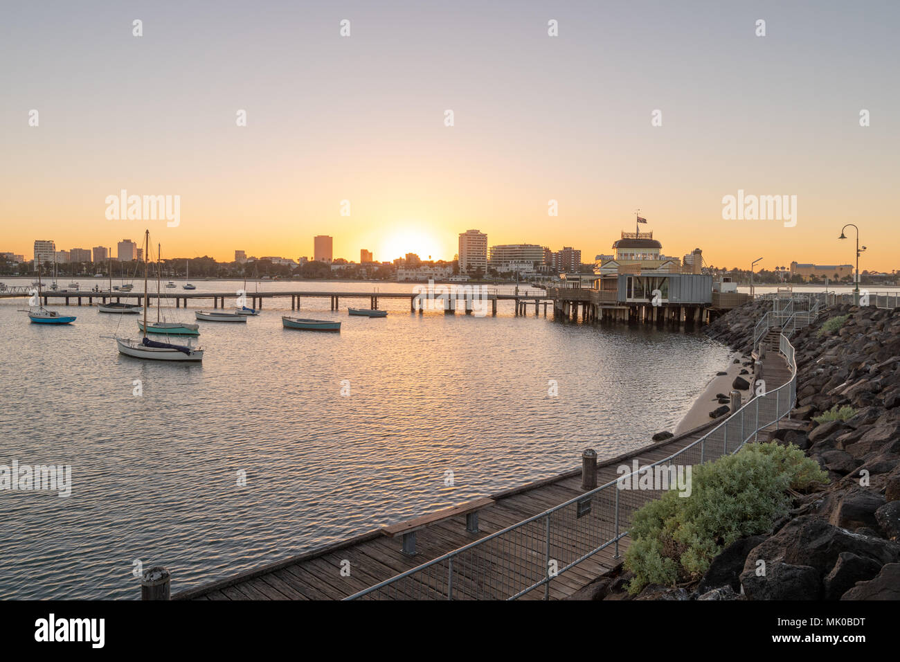 Sunrise over pier and town of St Kilda, Melbourne, Australia - Stock Image