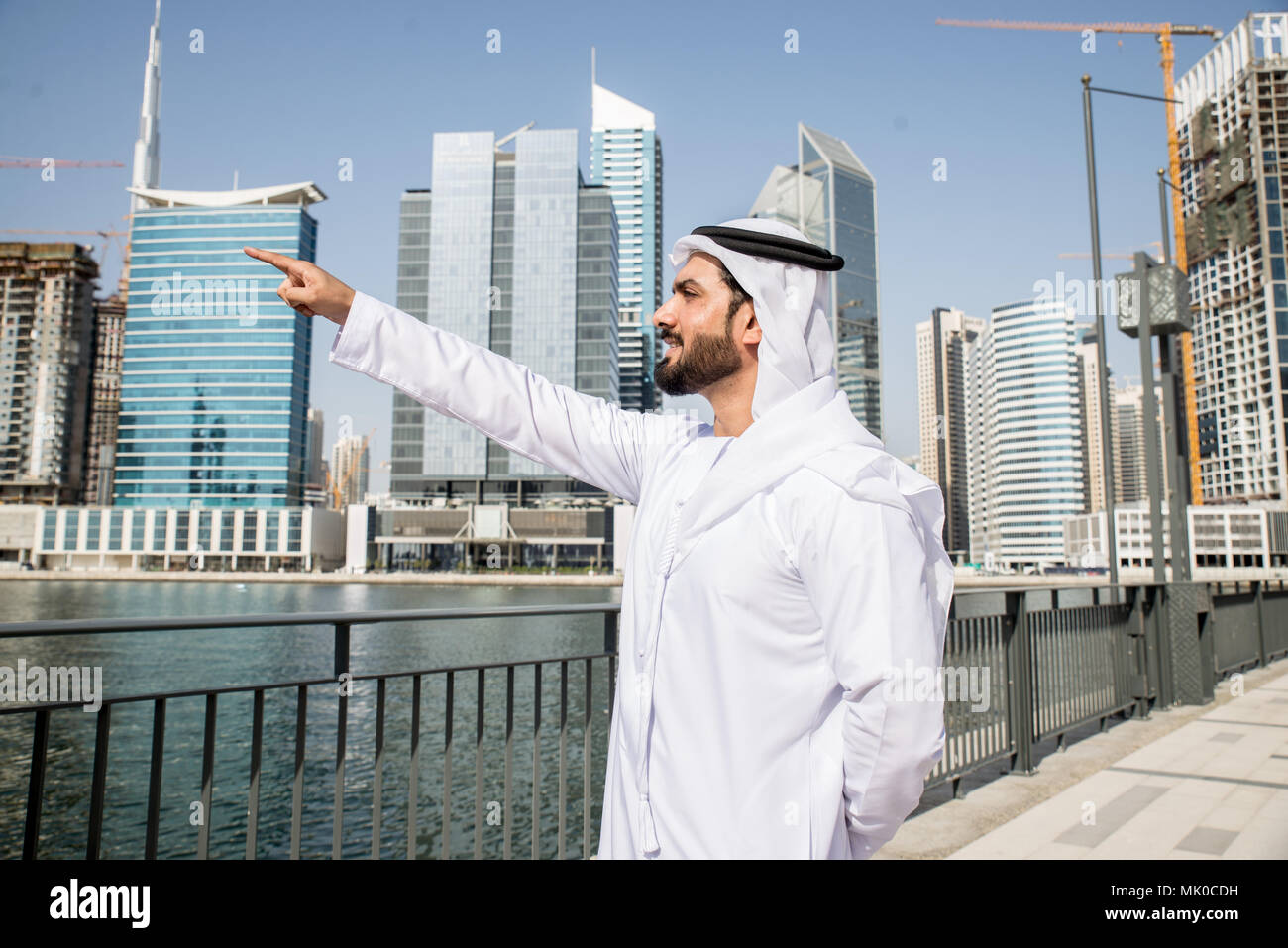 Arabic businessman wearing kandora - Portrait of traditional emirati man Stock Photo