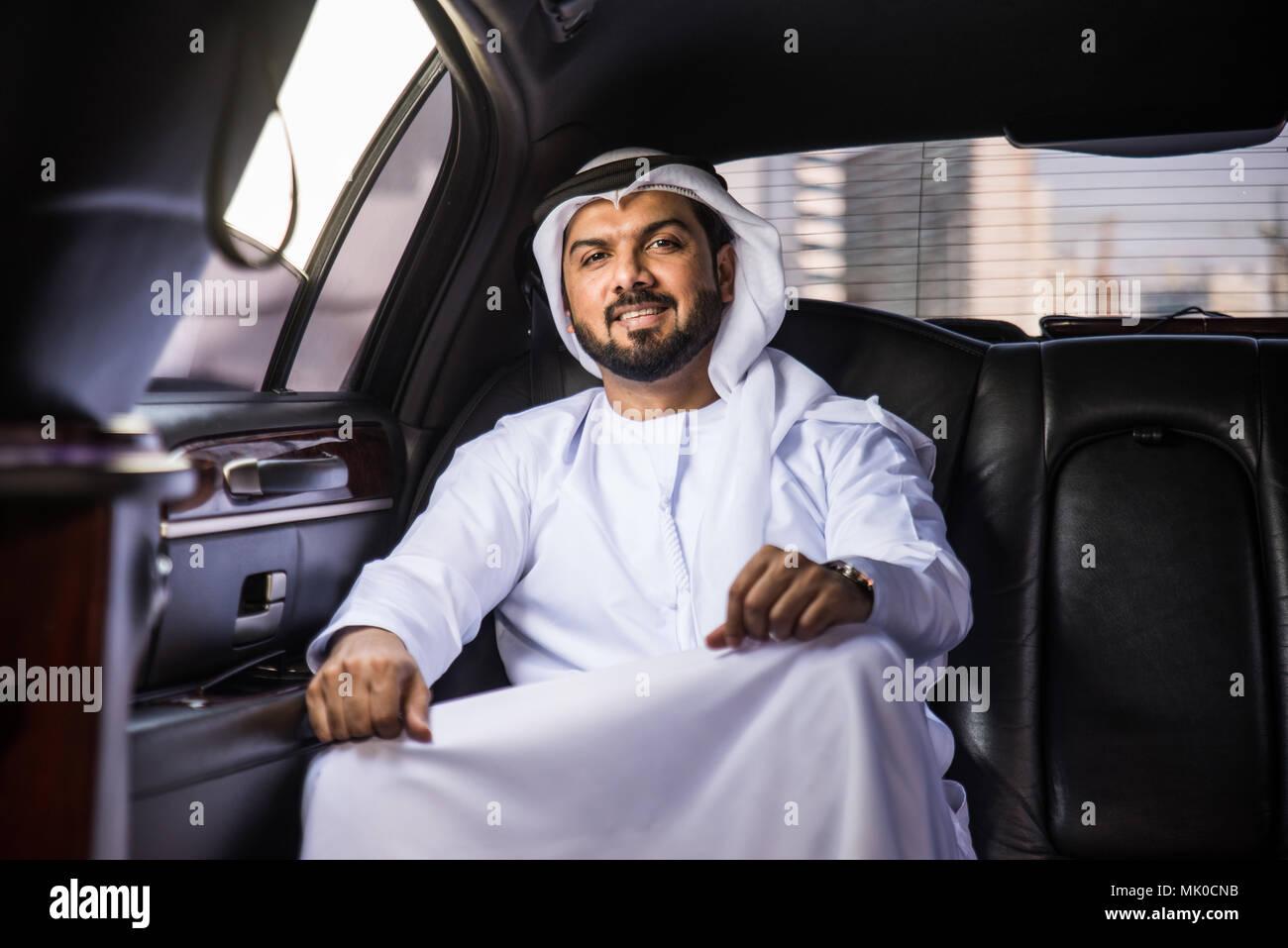 Arabic businessman wearing kandora - Portrait of traditional emirati man Stock Photo