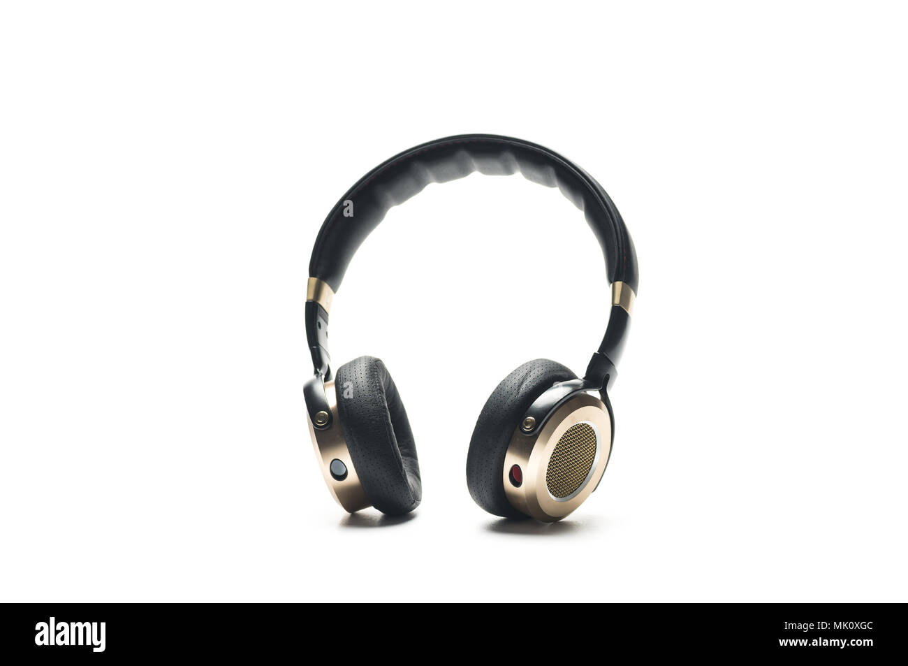 Black Headphones Isolated on White Background, with gold color and lether material. Stock Photo