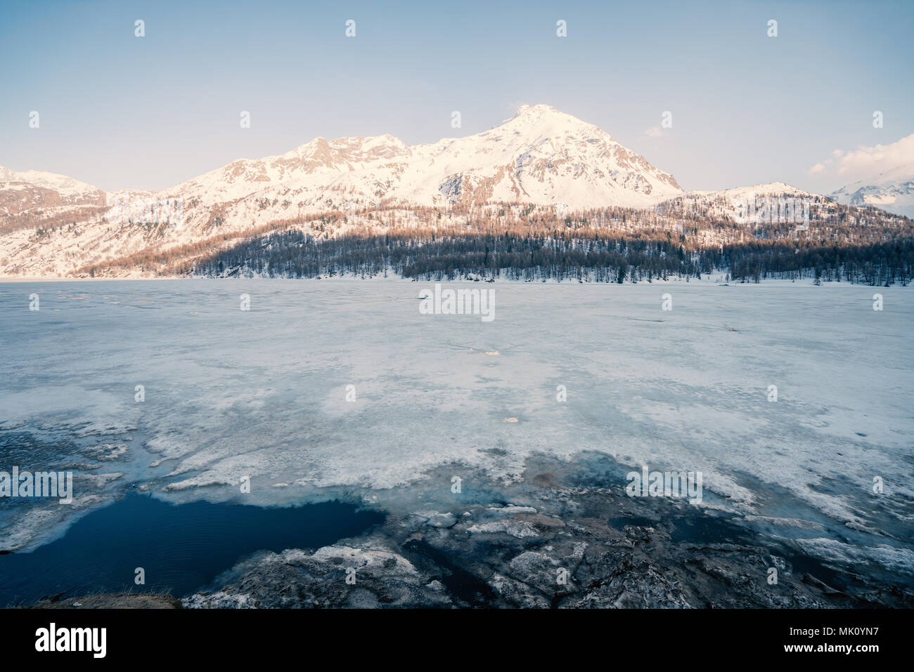 Beautiful view of frozen lake and snowcapped mountains in Graubunden Canton in Switzerland, Europe. Travel destinations no people concept Stock Photo