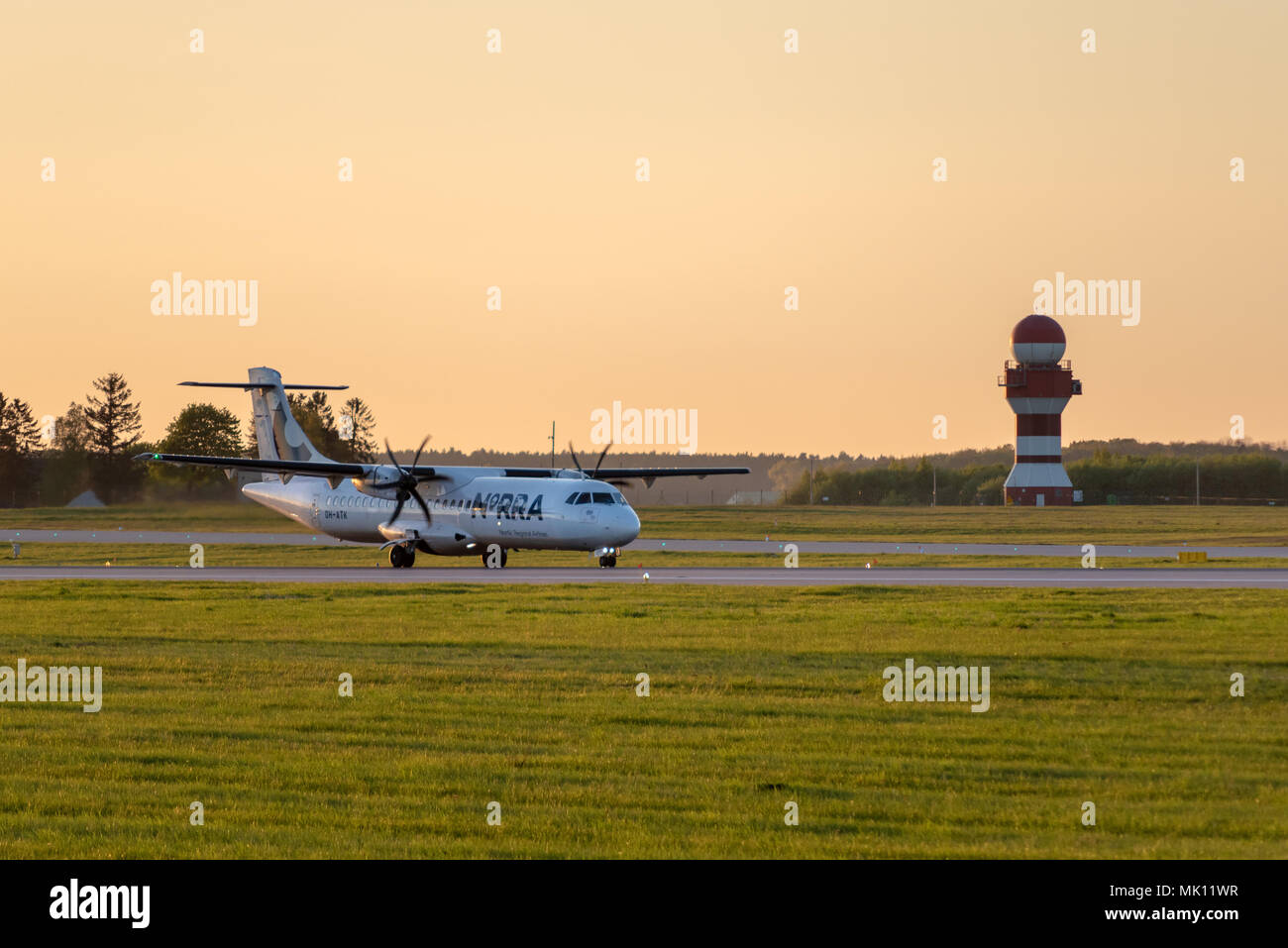GDANSK, POLAND - May 5, 2018: Nordic Regional Airlines (NORRA) airplane taxiing at Lech Walesa Airport in Gdansk. - Stock Image