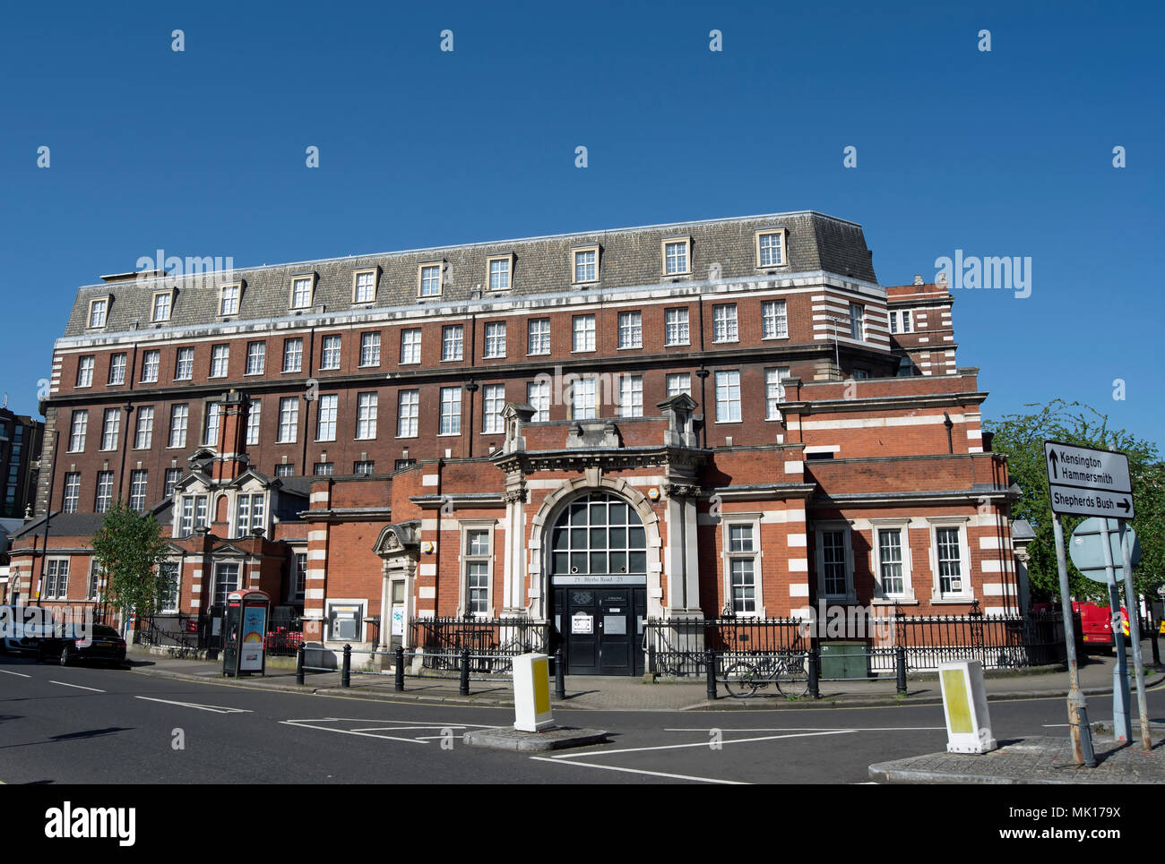 the 1920s east wing of blythe house, a grade II listed building of 1899 to 1903 seen in the background, west kensington, london, england - Stock Image