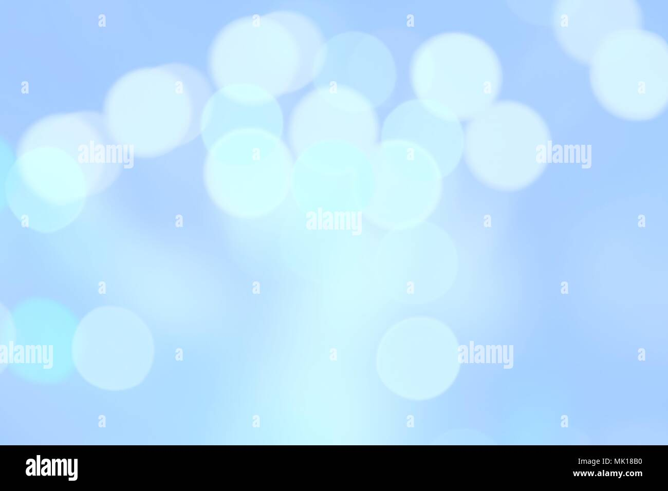Abstract blue color blurred bokeh light reflection for background - Stock Image