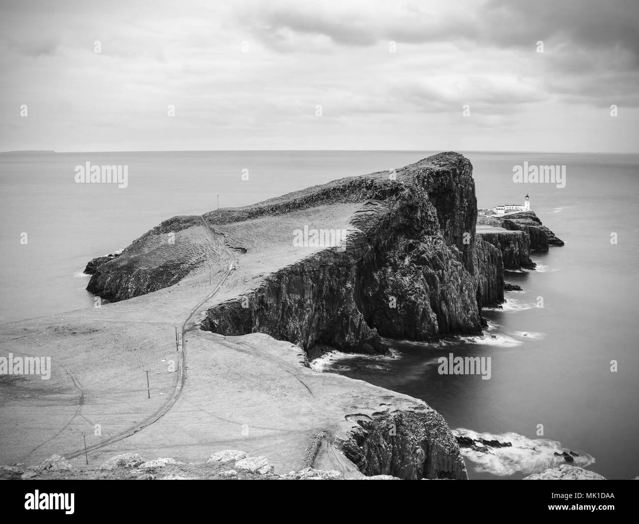 Cliffs of neist point cape and lighthouse in black and white popular travelers destination on isle of skye scotland