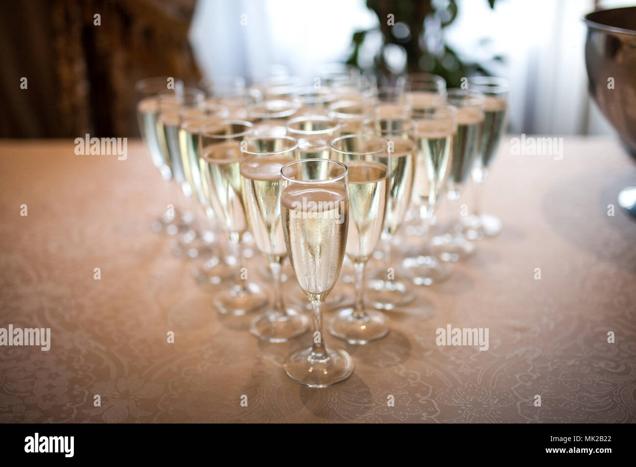 Glasses with champagne on the table - Stock Image
