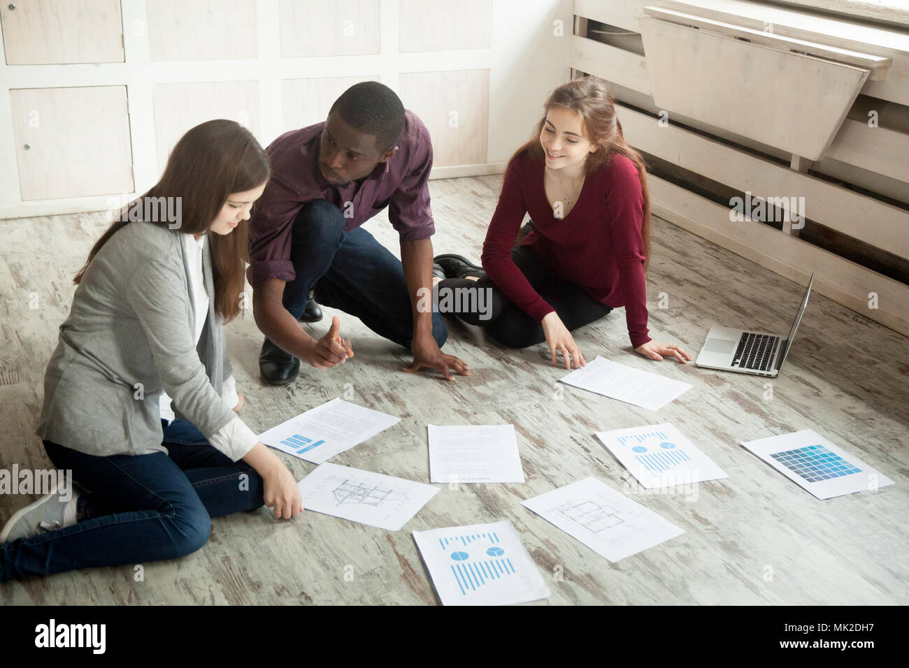Multiracial creative team brainstorming at office floor Stock Photo