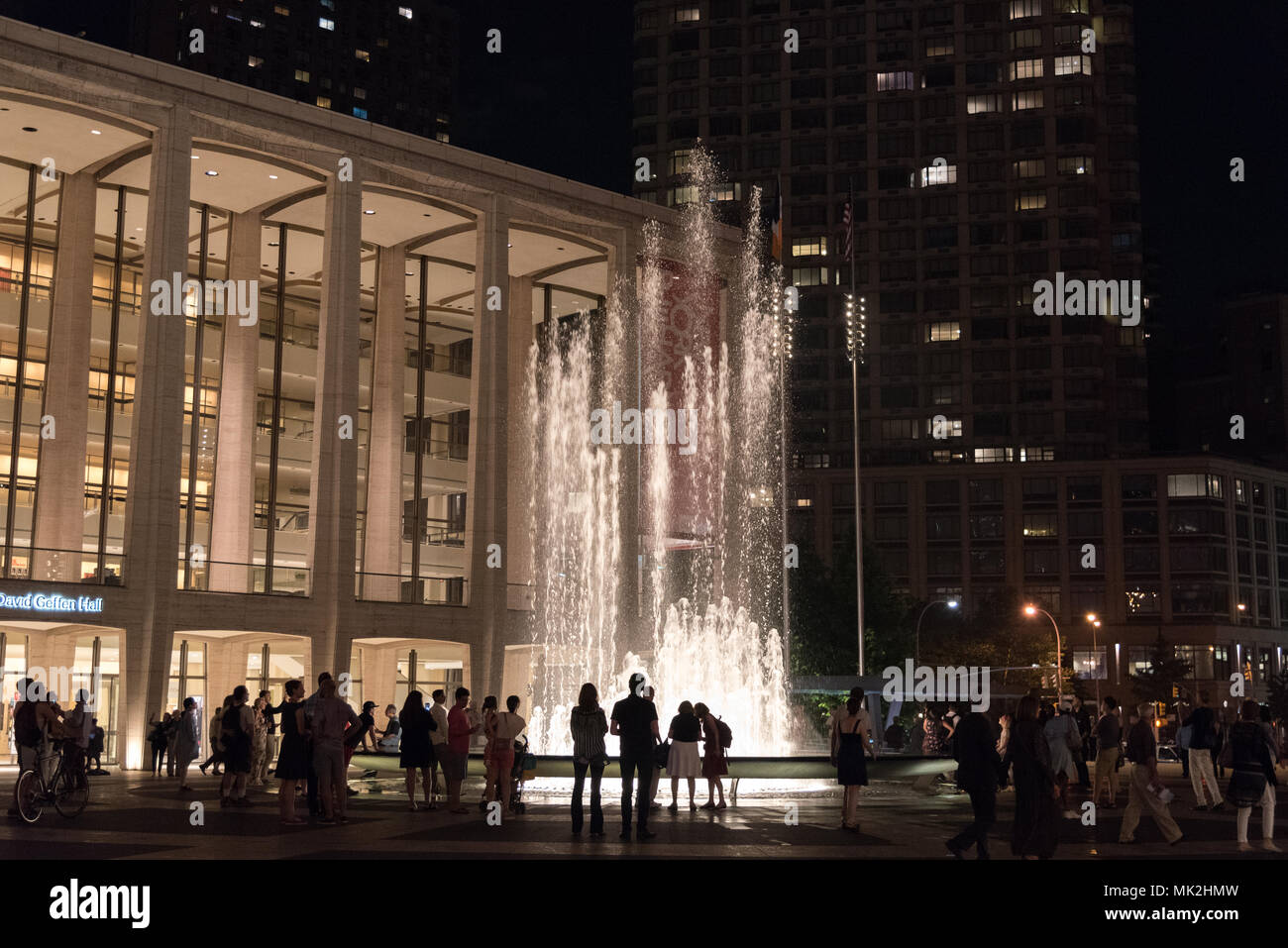July 4, 2017: People visiting the Lincoln Center, exploring its numerous cultural activities and enjoying a summer evening at the plaza, New York, USA - Stock Image