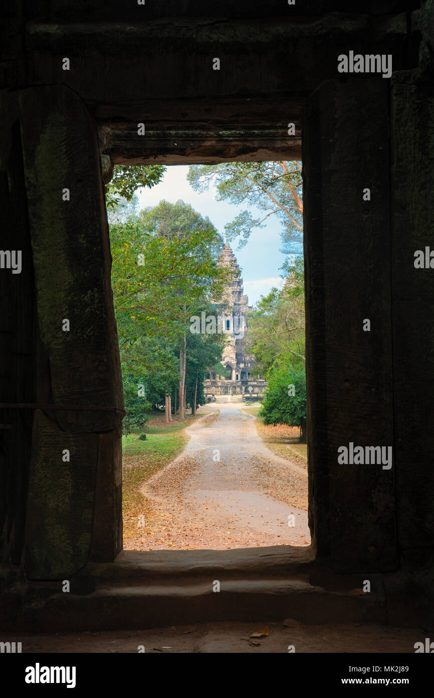 View of the Angkor Wat temple complex through the East Gate - Stock Image
