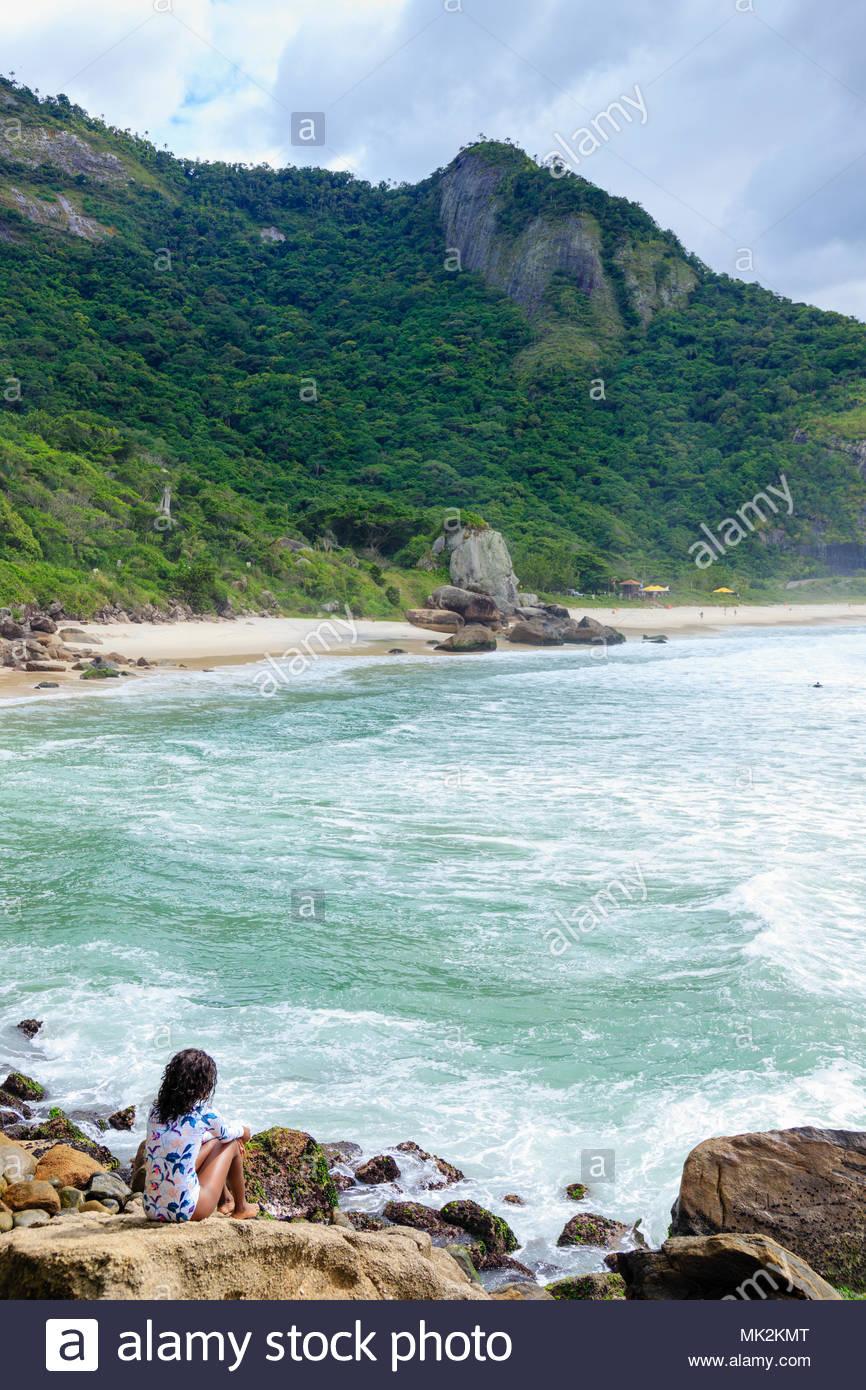A beautiful young African Brazilian woman on Prainha beach, Rio de Janeiro, Brazil - Stock Image