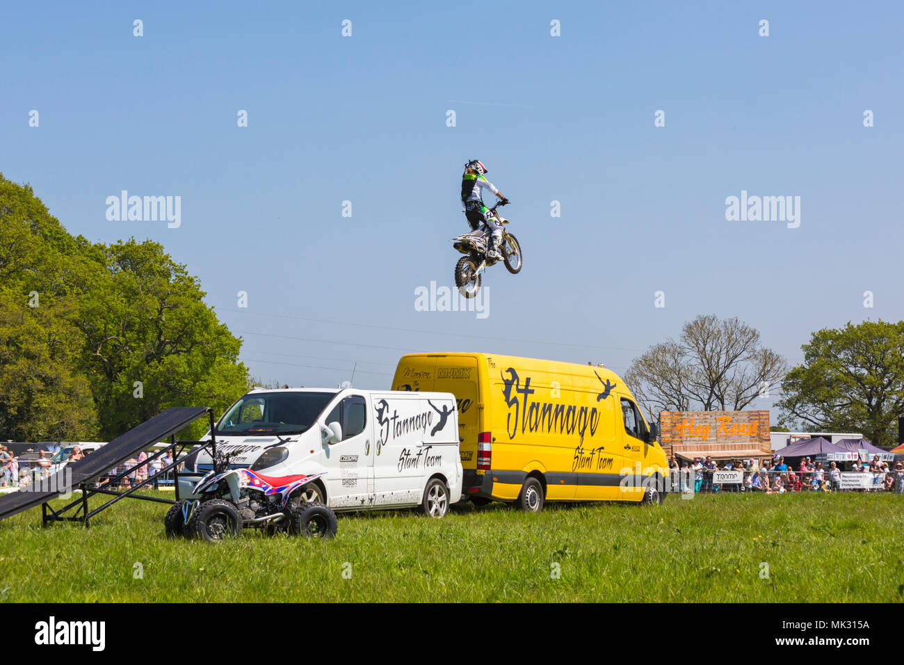 Netley Marsh, Hampshire, UK. 6th May 2018. The first day, of the two day event, Hampshire Game & Country Fair attracts the crowds on a hot sunny day. Stannage International Stunt Display Team thrill the crowds with their motorbike display. Credit: Carolyn Jenkins/Alamy Live News - Stock Image