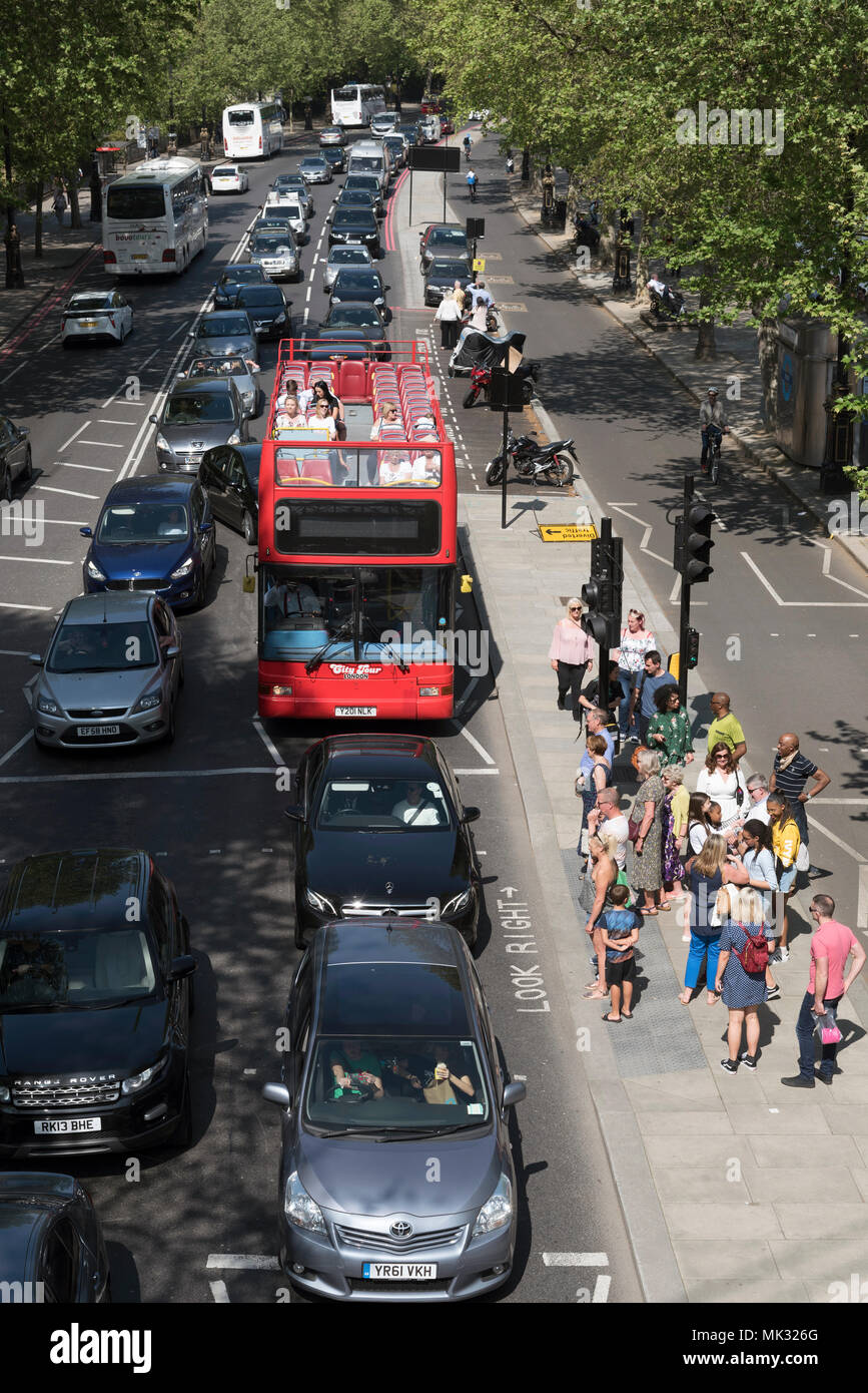 May 2018. The Embankment at Charing Cross, London, An overview of tourists and busy holiday traffic queueing nose to tail - Stock Image