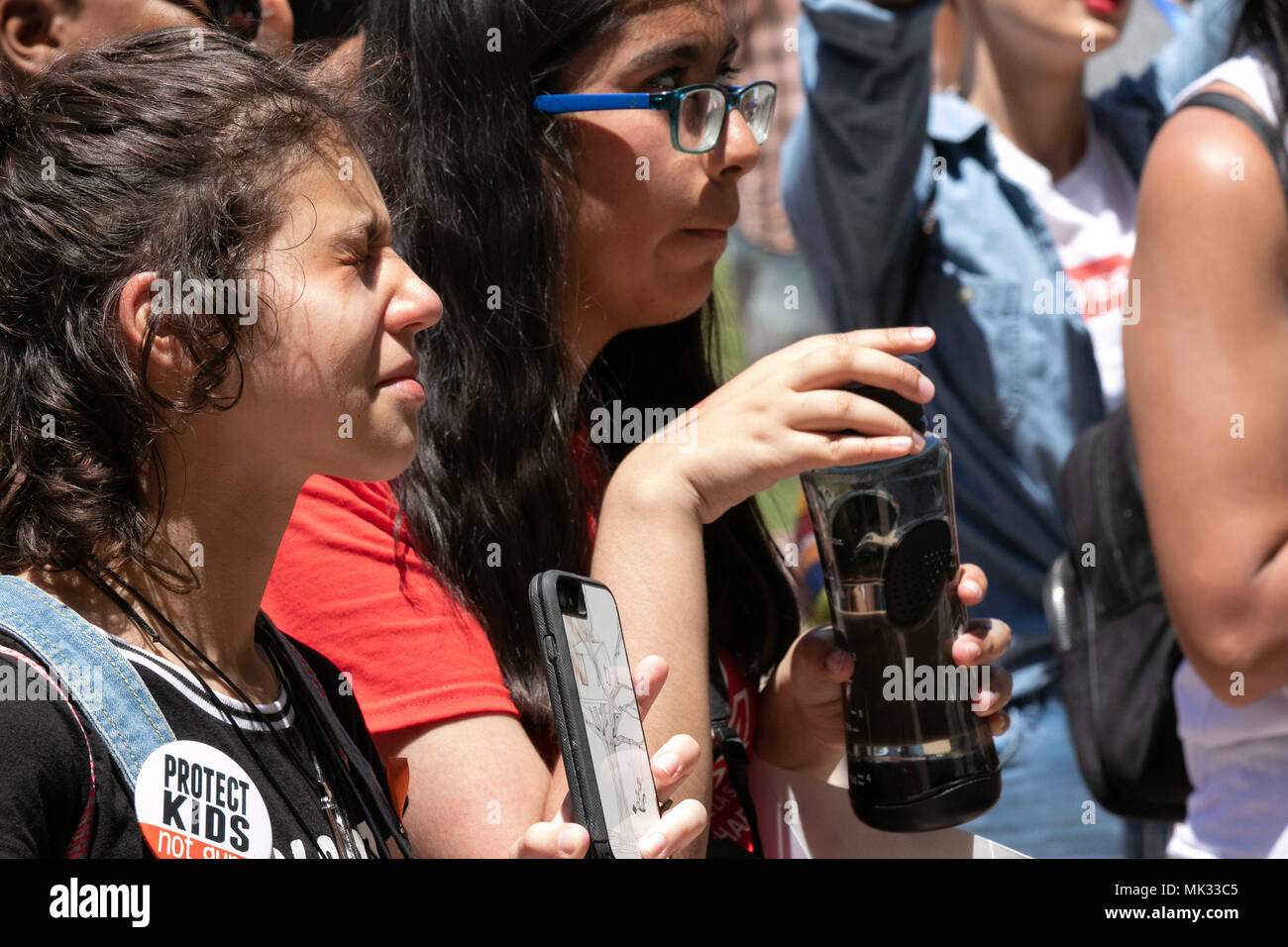 Dallas, USA. 05th May, 2018. A tearful demonstrator listens to the story of a gun violence victim at the NoRA protest in Dallas, Texas on May 5th, 2018. Credit: The Photo Access/Alamy Live News - Stock Image