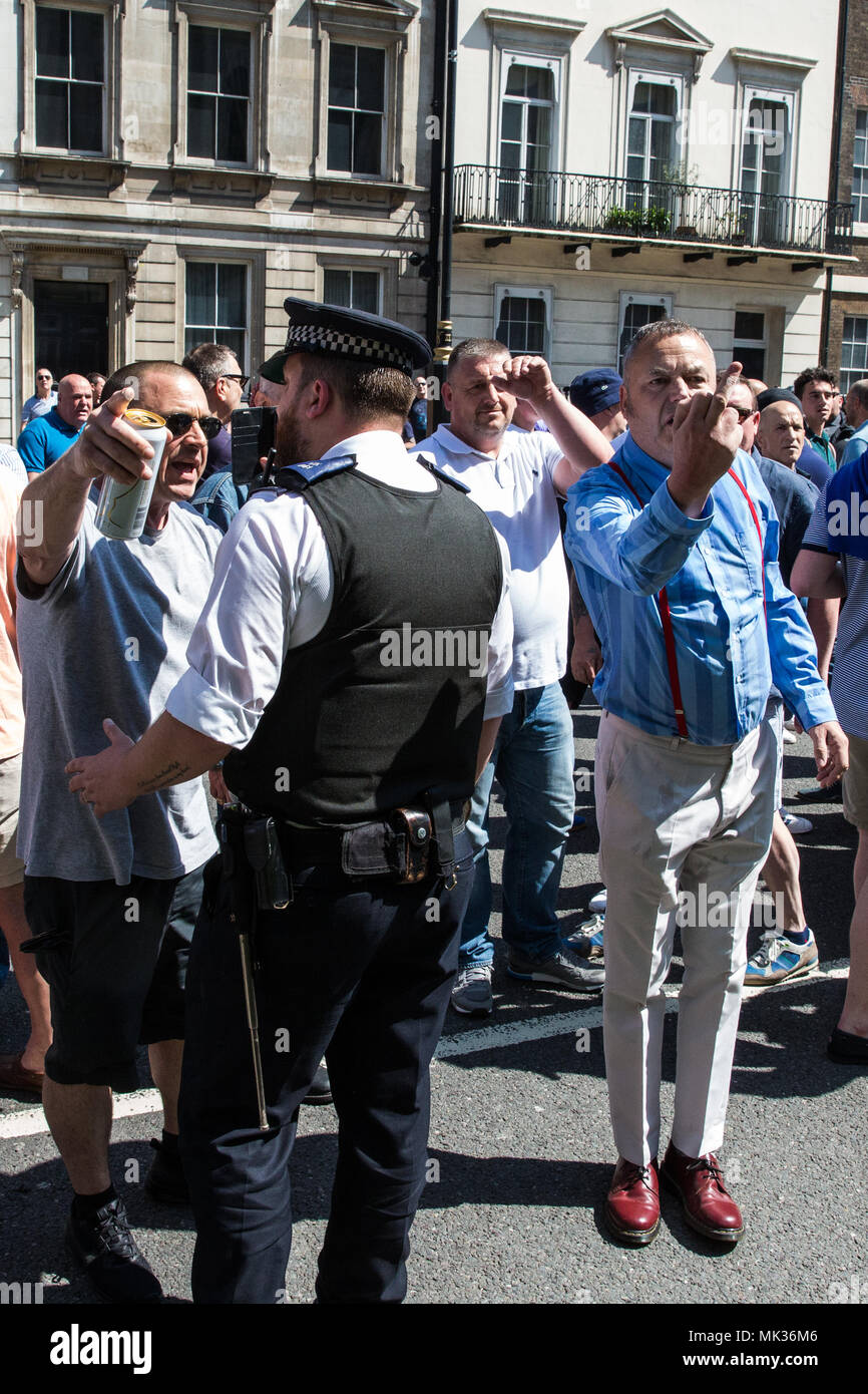 London, UK. 6th May, 2018. Supporters of the far-right Democratic Football Lads Alliance approach a counter-protest by anti-racist and anti-fascist groups to their 'Day of Freedom' in Whitehall. They had previously attacked the counter-protest before more police officers were drafted in to regain control. Credit: Mark Kerrison/Alamy Live News - Stock Image
