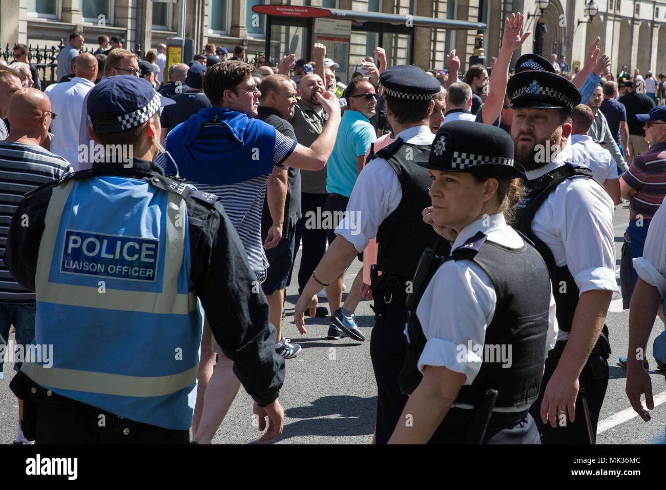 London, UK. 6th May, 2018. Supporters of the far-right Democratic Football Lads Alliance are moved on by police officers after attacking a counter-protest by anti-racist and anti-fascist groups to their 'Day of Freedom' in Whitehall. Credit: Mark Kerrison/Alamy Live News - Stock Image