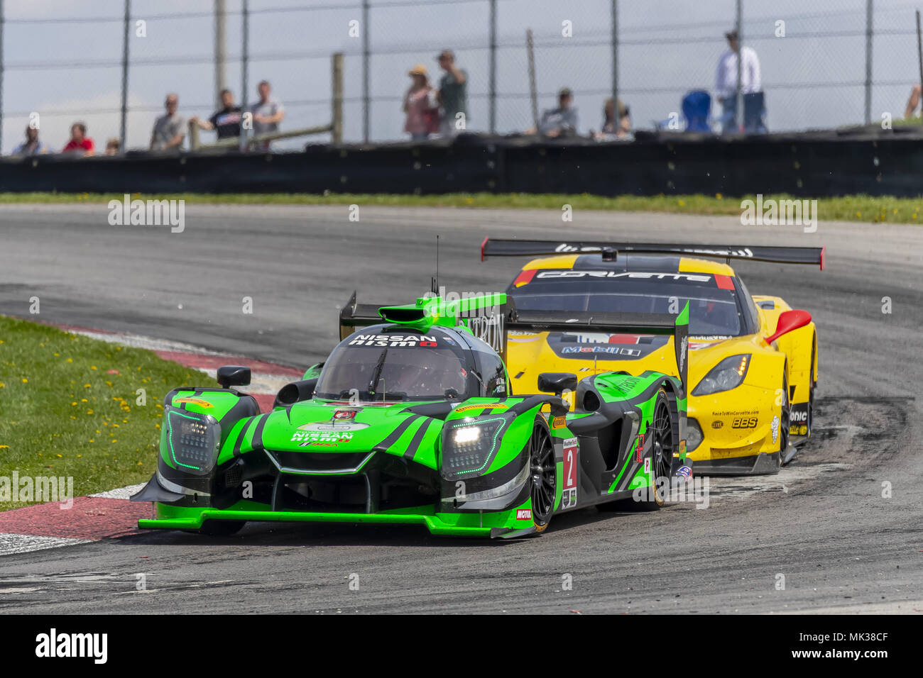 The Tequila Patron Nissan DPI Car Races Through The Keyhole Turn During The  The Acura Sports Car Challenge At Mid Ohio Sports Car Course In Lexington,  ...