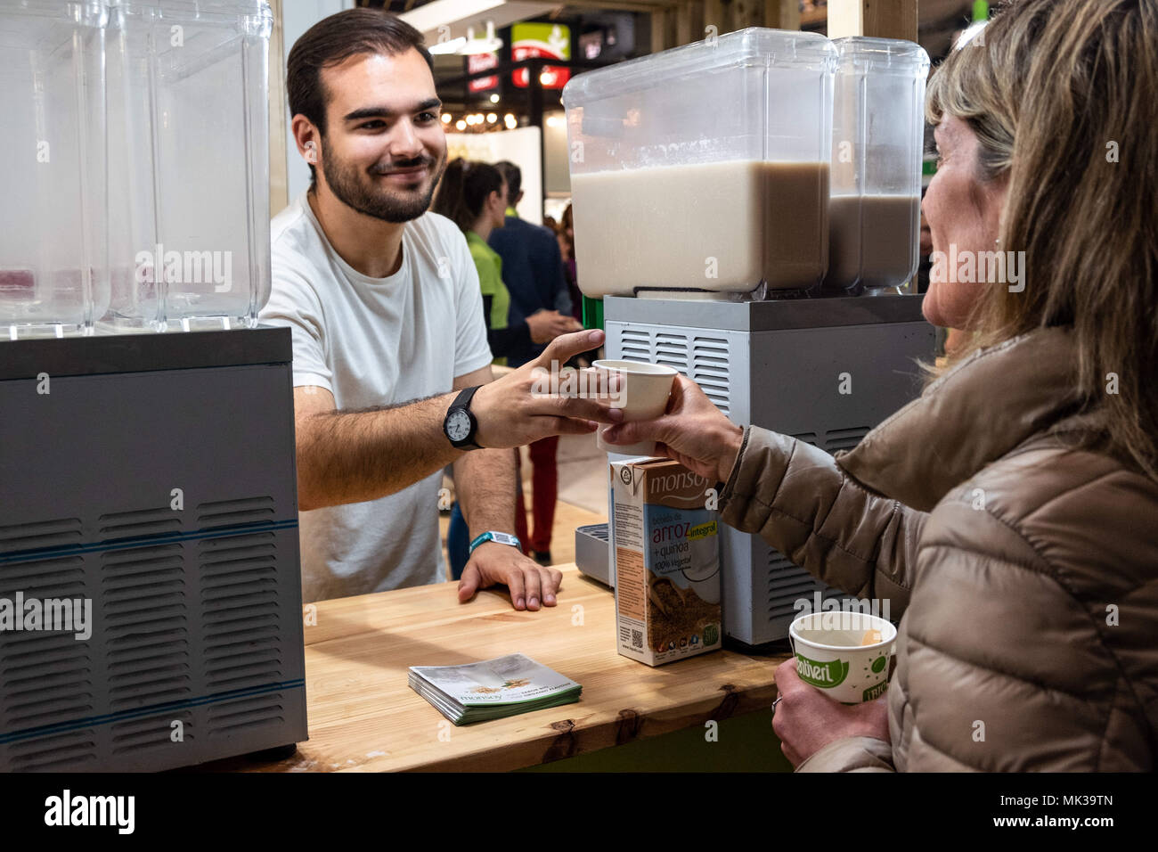 May 6, 2018 - Barcelona, Catalonia, Spain - Tasting of vegetable smoothies at the Organic Products Fair and Responsible Consumption in Barcelona. BioCultura, the Organic Products Fair and Responsible Consumption celebrates its 25th anniversary. It will bring together over 700 exhibitors dedicated to the sectors of food bio, organic cosmetics, sustainable fashion, home safe, responsible tourism, crafts and NGOs. Parallel to the exhibition more than 400 activities will be held and is expected to exceed 72,000 visitors. It will be held from 3 to 6 May at the Palau Sant Jordi in Barcelona. (Credit Stock Photo