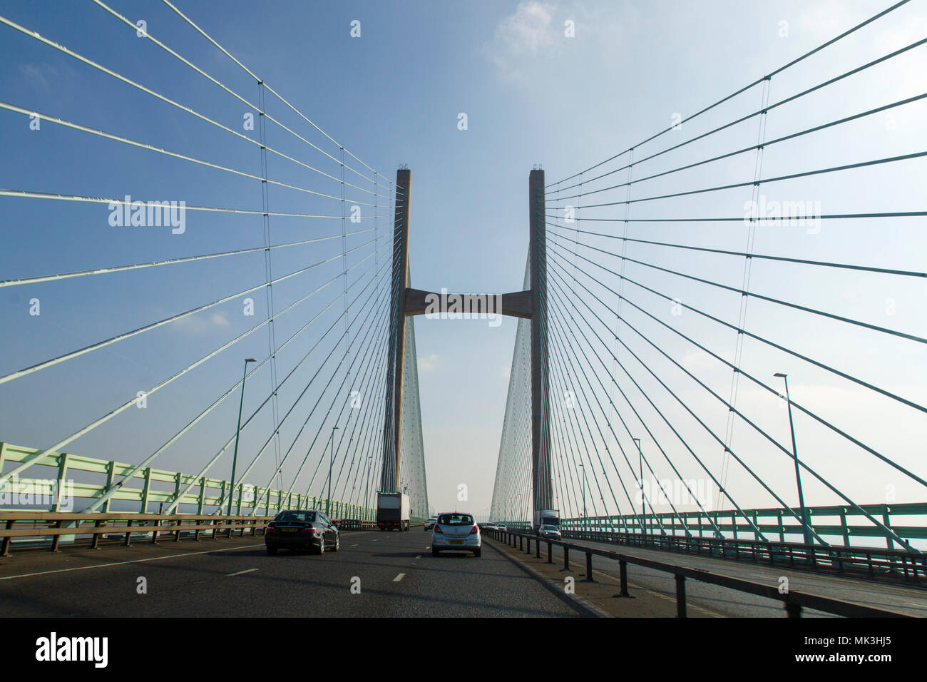 Chepstow, UK: February 24, 2018: Crossing the Severn Bridge eastward bound. Following traffic across the Severn River into England. Stock Photo